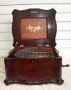 an image of Regina music box - 15.5 inch - short bedplate mahogany